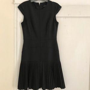 Black CAROLL pleated skirt dress.